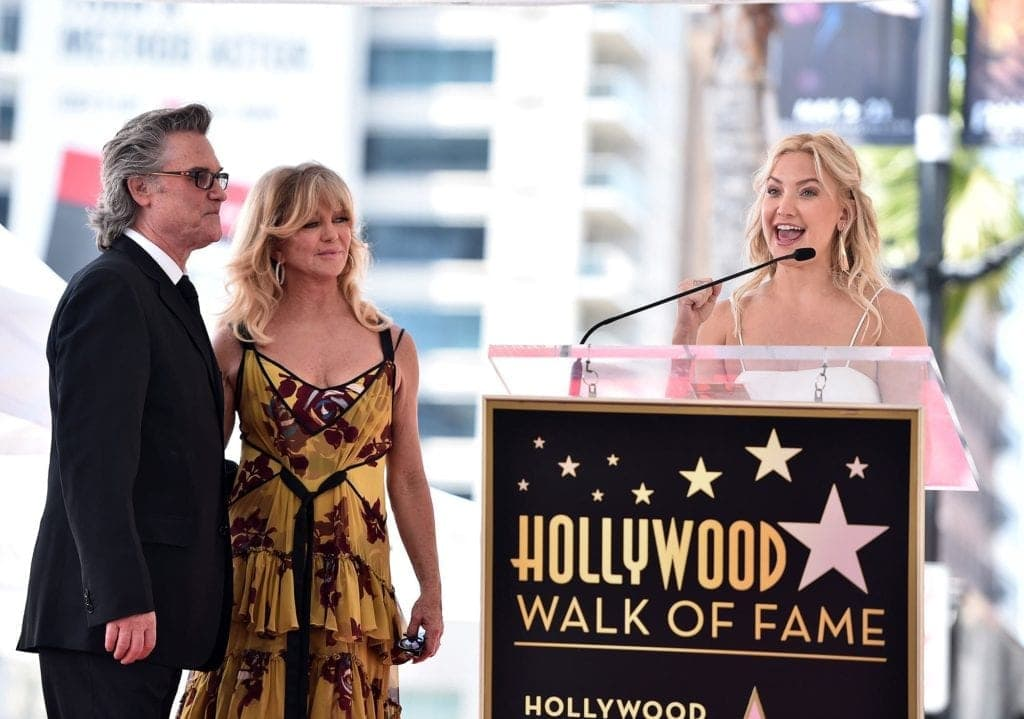 HOLLYWOOD, CA - MAY 04: Actors Kate Hudson (R) speaks onstage as Kurt Russell and Goldie Hawn are honored with a double star ceremony on the Hollywood Walk of Fame on May 4, 2017, in Hollywood, California. (Photo by Alberto E. Rodriguez/Getty Images)