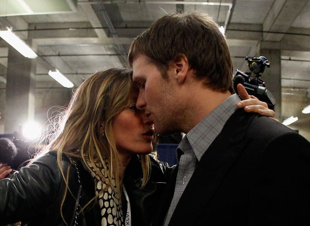 ORG XMIT: 135530024 INDIANAPOLIS, IN - FEBRUARY 05: Tom Brady #12 of the New England Patriots is comforted by his wife Gisele Bundchen after losing to the New York Giants by a score of 21-17 in Super Bowl XLVI at Lucas Oil Stadium on February 5, 2012 in Indianapolis, Indiana. (Photo by Rob Carr/Getty Images) ORIG FILE ID: 138327431