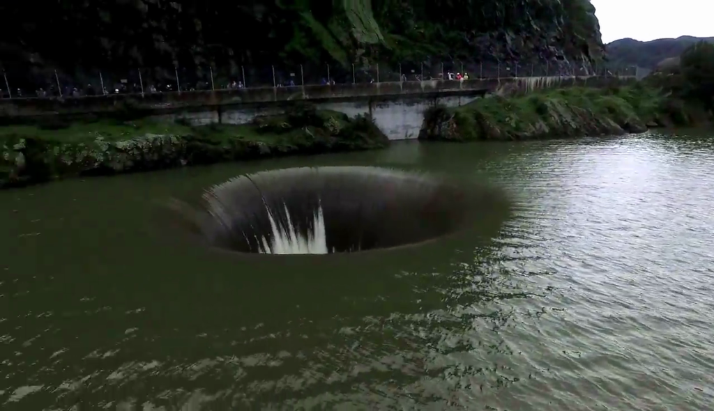 A Guy Flew His Drone Over A Strange Hole In A Lake And