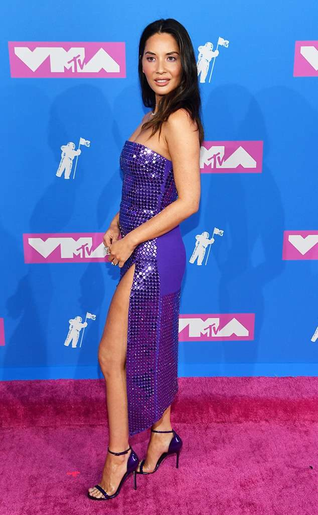 e434a54ba3b3 The actress and model never lets critics down when it comes to her fashion  choices. Munn donned this spectacular sparkling purple number, embracing  the ...